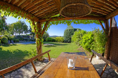 Table and garden in Provence. A table under a canopy and a garden in Provence, France Stock Photography