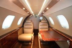 Table gauche d'arrière de cabine d'avion à réaction de petite entreprise Photographie stock