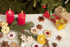 Table with gifts and christmas candles Stock Photos