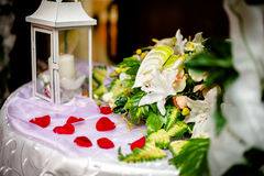 Table for gifts at the wedding. With rose petals Royalty Free Stock Photo