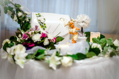 Table for gifts at the wedding. With white flowers Stock Photos
