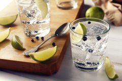 Table with gin tonic glasses and ingredients. White wood table with gin tonic glasses and their ingredients Royalty Free Stock Photography