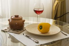 Table with glass of wine. Served table with glass of wine and ragout pot stock image