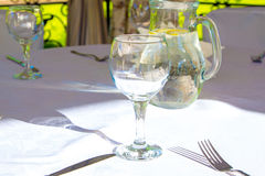 Table with glasses in bower Royalty Free Stock Photography