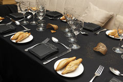 Table with glasses, bread and menu sheets. Stock Images