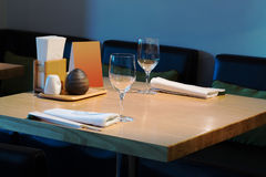 Table with glasses in the cozy cafe Stock Photography