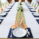 Table with the glasses and plates Royalty Free Stock Images