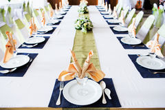 Table with the glasses and plates Stock Image