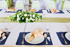 Table with the glasses and plates Royalty Free Stock Photography
