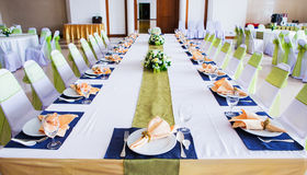 Table with the glasses and plates Royalty Free Stock Photo