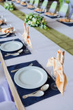 Table with the glasses and plates Stock Photography