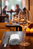 Table with glasses, towel, sticks in sushi bar Stock Image