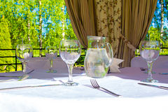 Table with glasses and white tablecloth Royalty Free Stock Image