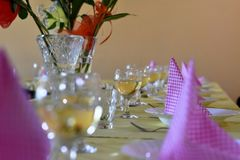 Table with glasses of wine. A celebrate table with glasses of wine and purple napkins royalty free stock photo