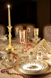 Table with gold dishes Royalty Free Stock Photography