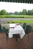 Table at golf course. Table on a patio at a golf course Royalty Free Stock Photography