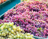 Table grapes. Bunches of red and green table grapes piled on a table at the Clement Street Farmer's Market in San Francisco stock photos