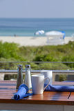 Table with a great beach view Royalty Free Stock Photos