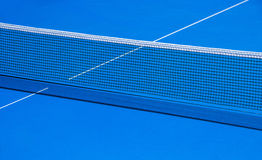 Table and grid for playing table tennis. Blue table and grid for playing ping-pong stock photos