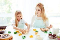 Table handmade cupcakes joy fun enjoy blonde birthday holiday pr. Epare raw support hobby motherhood parenthood concept. Cute portrait of mum  and daughter Royalty Free Stock Image