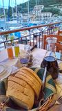 Table beside harbor in Greece stock photography