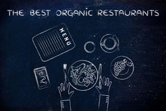Table with healthy food and text The best organic restaurants (f Royalty Free Stock Image