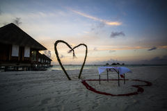 Table with hearts on beach in Maldives Stock Images