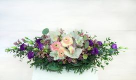 Table holiday composition for the interior. Table holiday composition for the interior with orchids and violet eustoma Stock Photography
