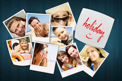 Table with holiday photos of happy joying people Royalty Free Stock Photography