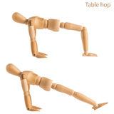 Table hop pose. Demonstration of wood manikin in table hop exercise pose on white background Stock Photos