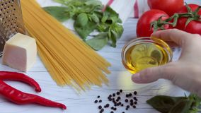 Table with ingredients for cooking spagetti stock video footage