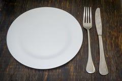 Table inställningen Matställeplatta, gaffel och kniv Royaltyfri Fotografi