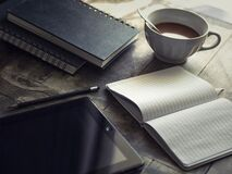 Table with journals and coffee Royalty Free Stock Image