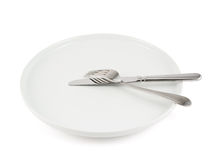 Table knife, fork and ceramic plate isolated Stock Photography