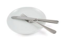 Table knife, fork and ceramic plate isolated Stock Images