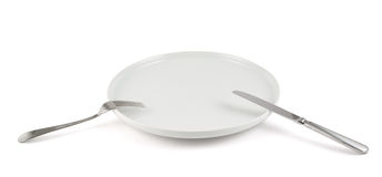 Table knife, fork and ceramic plate isolated Royalty Free Stock Photography