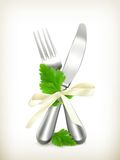 Table knife and fork with parsley Stock Photography