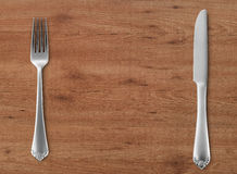 Table knife and fork on wood Royalty Free Stock Photography