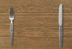 Table knife and fork on wood Stock Images