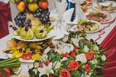 The table is Laden with dishes 7847. Densely Laden with dishes of the table Stock Photo