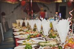 Densely Laden with dishes of the table. The table is Laden with dishes Stock Photography
