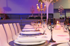 Table laid for a banquet. Wedding or holiday Royalty Free Stock Image