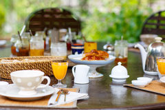 Table laid for breakfast outside with various jams coffee, crois Royalty Free Stock Photos