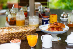 Table laid for breakfast outside with various jams coffee, crois Royalty Free Stock Photo