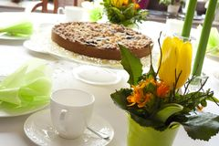 Table laid for coffee and cake Stock Images