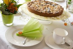 Table laid for coffee and cake Royalty Free Stock Photo