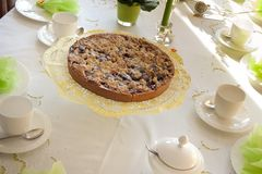 Table laid for coffee and cake Royalty Free Stock Image