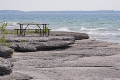 Table on a lakeshore Royalty Free Stock Photos