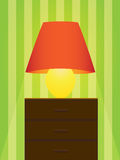 Table lamp. Old fashion table lamp against wallpaper Royalty Free Stock Photography