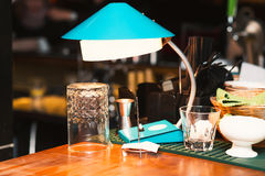 Table lamp on the bar. Empty glass. On the bar background. Quiet evening in the bar. Alcohol party at the bar. Before party stock photography